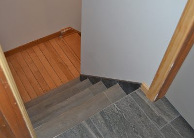 Tile stairs going down from bathroom