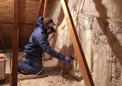 Spray foaming attic wall